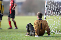 The Juva FC goalkeeper sits by the goal during a Hackney & Leyton Sunday League match at Hackney Marshes - 02/12/07 - MANDATORY CREDIT: Gavin Ellis/TGSPHOTO - Self billing applies where appropriate - Tel: 0845 094 6026