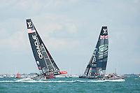 25 July 2015: Oracle Team USA competes with Land Rover BAR during the America's Cup first round racing off Portsmouth, England (Photo by Rob Munro),