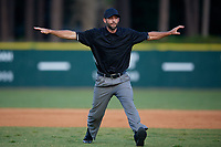 Umpire Jesse Osborne signals safe on a play during a Collegiate Summer League game between the Macon Bacon and Savannah Bananas on July 15, 2020 at Grayson Stadium in Savannah, Georgia.  (Mike Janes/Four Seam Images)