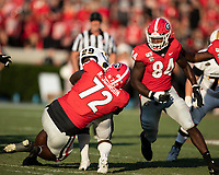 ATHENS, GA - SEPTEMBER 7: Netori Johnson #72 attempts to tackle running back MJ Fuller #29 during a game between Murray State Racers and University of Georgia Bulldogs at Sanford Stadium on September 7, 2019 in Athens, Georgia.