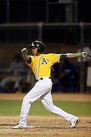 Yario Munoz #2 of the AZL Athletics bats against the AZL Dodgers at Phoenix Municipal Stadium on July 10, 2013 in Phoenix, Arizona. AZL Athletics defeated the AZL Dodgers, 7-1. (Larry Goren/Four Seam Images)