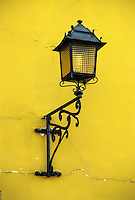Peru, Yucay.  Old Lamp on Side of House.