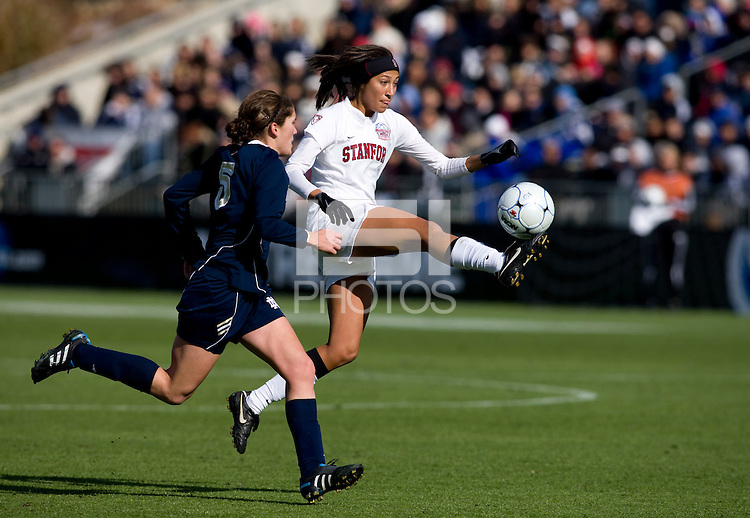 Christen Press (23) of Stanford takes a first touch on the ball in front of Molly Campbell (5) of Notre Dame during the final of the NCAA Women's College Cup at WakeMed Soccer Park in Cary, NC.  Notre Dame defeated Stanford, 1-0.