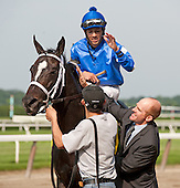 Artie Magnusson, assistant to trainer Kieran McLaughlin, greets It's Tricky and Eddie Castro after the Ogden Phipps.