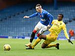 25.10.2020 Rangers v Livingston: Ryan Kent tackled by Efe Ambrose