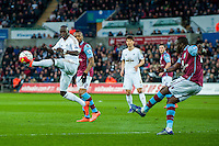 Modou Barrow of Swansea City  dries to block the ball during the Barclays Premier League match between Swansea City and Aston Villa played at the Liberty Stadium, Swansea  on March the 19th 2016