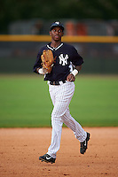 GCL Yankees 1 outfielder Terrance Robertson (81) jogs to the dugout during a game against the GCL Yankees 2 on July 29, 2015 at the Yankee Minor League Complex in Tampa, Florida.  The game was suspended after two innings due to rain.  (Mike Janes/Four Seam Images)