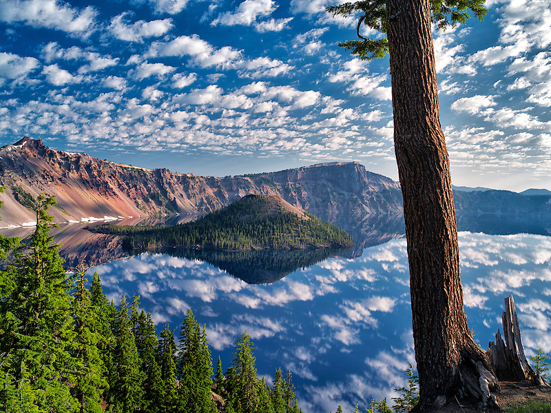Puffy cloud reflection, Crater Lake and Wizard Island. Crater Lake National Park, Oregon
