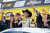 Oct 7, 2018; Ennis, TX, USA; NHRA pro stock driver Tanner Gray celebrates with crew after winning the Fall Nationals at the Texas Motorplex. Mandatory Credit: Mark J. Rebilas-USA TODAY Sports