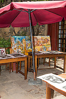 Works on Display in a Courtyard, Biannual Arts Festival, Goree Island, Senegal.