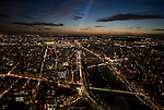 An evening view of Paris France from the Eiffel tower. The Seine river runs through the city below.