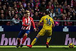 Antoine Griezmann (L) of Atletico de Madrid is tackled by Jairo Samperio Bustara of UD Las Palmas during the La Liga 2017-18 match between Atletico de Madrid and UD Las Palmas at Wanda Metropolitano on January 28 2018 in Madrid, Spain. Photo by Diego Souto / Power Sport Images