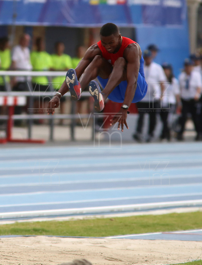 BARRANQUILLA - COLOMBIA, 29-07-2018:  Leonel Suarez, de Cuba, durante su participación en la prueba de Salto Largo, Masculino de la prueba del Decatlón, en el Estadio de Atletismo, como parte de los Juegos Centroamericanos y del Caribe Barranquilla 2018. / Leonel Suarez, from Cuba, during his participation in the Long Jump, Male, test, at the Athletics Stadium, as a part of the Central American and Caribbean Sports Games Barranquilla 2018. Photo: VizzorImage / Cont.