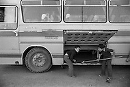 Children employed to upload luggage in the bus  in Istanbul, Turkey - Child labor as seen around the world between 1979 and 1980 – Photographer Jean Pierre Laffont, touched by the suffering of child workers, chronicled their plight in 12 countries over the course of one year.  Laffont was awarded The World Press Award and Madeline Ross Award among many others for his work.
