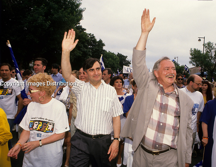 Montreal (Qc) CANADA,1995 File Photo <br /> Bloc Quebecois leader , Lucien Bouchard ( L) and<br /> Parti Quebecois  Leader Jacques Parizeau (R) wave at the crowd during the Saint Jean Baptiste parade, June 24, 1994 <br /> <br /> Photo by Pierre Roussel / Images Distribution