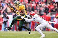 North Dakota State's running back King Frazier (22) attempts to rush past Jacksonville State's linebacker Joel McCandless (3) during NCAA Division I Football Championship, in Frisco, Tex. Saturday, Jan. 09, 2016. North Dakota State leads 24-0 at the halftime. (TFV Media via AP) ** Mandatory Credit **
