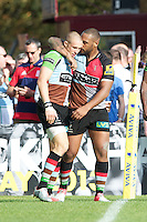 Mike Brown of Harlequins (left) is congratulated by team mate Jordan Turner-Hall after scoring a bonus point try during the Aviva Premiership match between Harlequins and Sale Sharks at The Twickenham Stoop on Saturday 15th September 2012 (Photo by Rob Munro)