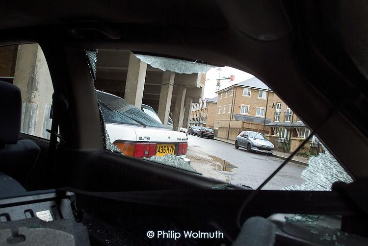 Smashed car window in Paddington, London.