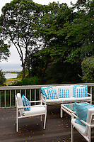 House's exterior area<br /> <br /> A modern New England seaside style house in North Fork, Long Island. The two story 3,000 sq. ft home has a picture perfect view  facing an inlet and the Long Island Sound.