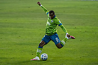SAN JOSE, CA - OCTOBER 18: Nouhou Tolo #5 of the Seattle Sounders takes a shot during a game between Seattle Sounders FC and San Jose Earthquakes at Earthquakes Stadium on October 18, 2020 in San Jose, California.