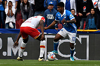 BOGOTA - COLOMBIA - 16 - 07 - 2017: Harold Mosquera (Der.) jugador de Millonarios disputa el balón con Javier Lopez (Izq.) jugador de El Independiente Santa Fe, durante partido de la fecha 2 entre Millonarios y el Independiente Santa Fe, por la Liga Aguila II-2017, jugado en el estadio Nemesio Camacho El Campin de la ciudad de Bogota. / Harold Mosquera (R) player of Millonarios vies for the ball with Javier Lopez (L) player of Independiente Santa Fe, during a match of the date 2nd between Millonarios and Independiente Santa Fe, for the Liga Aguila II-2017 played at the Nemesio Camacho El Campin Stadium in Bogota city, Photo: VizzorImage / Luis Ramirez / Staff.