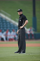 Umpire Joe Belangia handles the calls on the bases during the game between the Jersey Shore BlueClaws and the Winston-Salem Warthogs at Truist Stadium on July 21, 2021 in Winston-Salem, North Carolina. (Brian Westerholt/Four Seam Images)