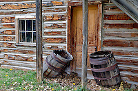 Door entry into historic old house and barrels. Nevada City, Montana