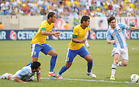 Argentina forward Lionel Messi (10) runs with the ball against Brazil defender Casemiro (15) The Argentina National Team defeated Brazil 4-3 at MetLife Stadium, Saturday July 9 , 2012.