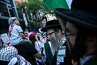 NEW YORK, NY - JUNE 15: Pro-Palestinian Orthodox Jews protest in New York on June 15, 2021. The solidarity action of hundreds of pro-Palestinians is a form of support against the attacks carried out by the Israeli government. At the same time, Palestinian Prime Minister Mohammad Shtayyeh says the new Israeli government is just as bad as the old one and condemns Naftali Bennett's announcements in support of Israeli settlements. That is why the demonstrations continue in different parts of the world. (Photo by Pablo Monsalve / VIEWpress via Getty Images