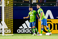 CARSON, CA - SEPTEMBER 27: Cristian Roldan #7 and team mate Will Bruin #17 of the Seattle Sounders celebrate Cristian's goal during a game between Seattle Sounders FC and Los Angeles Galaxy at Dignity Heath Sports Park on September 27, 2020 in Carson, California.