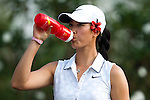 CHON BURI, THAILAND - FEBRUARY 17:  Michelle Wie of USA drinks on the 18th hole during day one of the LPGA Thailand at Siam Country Club on February 17, 2011 in Chon Buri, Thailand. Photo by Victor Fraile / The Power of Sport Images