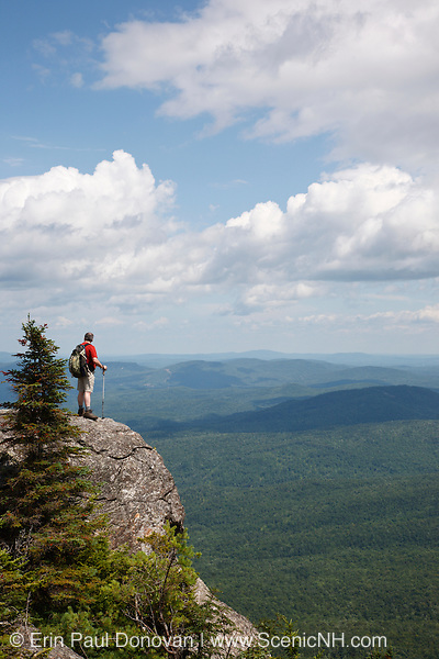 Caribou - Speckled Mountain Wilderness - A hiker explores the exposed summit of Caribou Mountain in the White Mountain National Forest of Maine