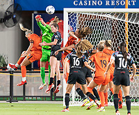 HOUSTON, TX - SEPTEMBER 10: Jane Campbell #1 of the Houston Dash knocks the ball away from her goal between Rachel Daly #3 and Arin Wright #3 of the Chicago Red Stars during a game between Chicago Red Stars and Houston Dash at BBVA Stadium on September 10, 2021 in Houston, Texas.