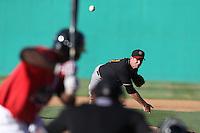 Devin Burke #41of the Modesto Nuts pitches against the High Desert Mavericks at Heritage Field on June 29, 2014 in Adelanto, California. High Desert defeated Modesto, 6-1. (Larry Goren/Four Seam Images)
