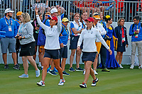 5th September 2021; Toledo, Ohio, USA;  Danielle Kang and Austin Ernst of Team USA walk to the first tee during the morning Four-Ball competition during the Solheim Cup on September 5th