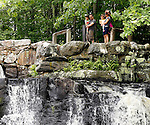 Southbury, CT- 21 June 2015-0602115CM02-  Eril Eti, left, holds Demir, 3 with his wife Envera Eti, and their daughter  Derya 2, all of Southbury, as they overlook the falls at Southford Falls State Park in Southbury on Sunday.  The family was out enjoying the afternoon as sun broke out following an overcast start to the day.  According to the National Weather Service, Monday is expected to be mostly sunny, with a high near 85.   Christopher Massa Republican-American