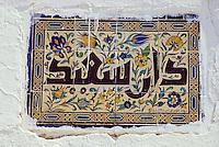 "Tunisia, Sidi Bou Said.  Hotel Name (""Dar Said"", ""Happy Abode"") in Tiles on Wall."