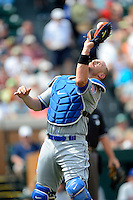 New York Mets catcher John Buck #44 catches a foul pop up during a Spring Training game against the Detroit Tigers at Joker Marchant Stadium on March 11, 2013 in Lakeland, Florida.  New York defeated Detroit 11-0.  (Mike Janes/Four Seam Images)