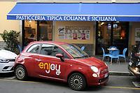 - Milano, quartiere Ortica, car sharing Enjoy<br /> <br /> - Milan, Ortica district, car sharing Enjoy