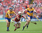 Luke Meade of Cork in action against David Mc Inerney and David Fitzgerald of Clare during their Munster senior hurling final at Thurles. Photograph by John Kelly.