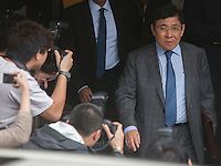 Billionaire property developer Raymond Kwok is seen arriving at the High Court of Hong Kong on day one of Hong Kong's most high profile corruption case in history, Hong Kong, China, 08 May 2014. The two property tycoon Kwok brothers Thomas and Raymond Kwok, as well as Rafael Hui who was once Hong Kong's second most senior official, are being charged with misconduct in public office relating to a high profile bribery scandal.