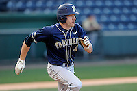 Right fielder Casey Roche (41) of the University of Pittsburgh Panthers runs out a ground ball in a game against the Presbyterian Blue Hose on Tuesday, March 11, 2014, at Fluor Field at the West End in Greenville, South Carolina. Pitt won, 12-3. (Tom Priddy/Four Seam Images)