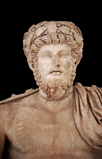 Roman sculpture of the Emperor Lucius Verus, excavated from Bulla Regia Theatre, sculpted circa 161-169 AD. The Bardo National Museum, Tunis.  Against a black background.