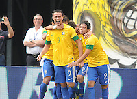 Brazil midfielder Oscar (10) celebrates his score with teammates in the 56th minute of the game. The Argentina National Team defeated Brazil 4-3 at MetLife Stadium, Saturday July 9 , 2012.