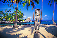 "Giant wooden carved statues stand on eternal guard at the Pu'u o Honaunau National Historic Park in South Kona on the big isle of Hawaii. It is also known as the """"City of Refuge"""" as it was used as a safe haven for vanquished soldiers and Kapu (rule) breakers."