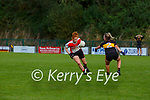Louise Ni Muircheartaigh Chorca Dhuibhne takes on Dr Crokes defence  during their Intermediate Championship semi final in Lewis Road on Sunday