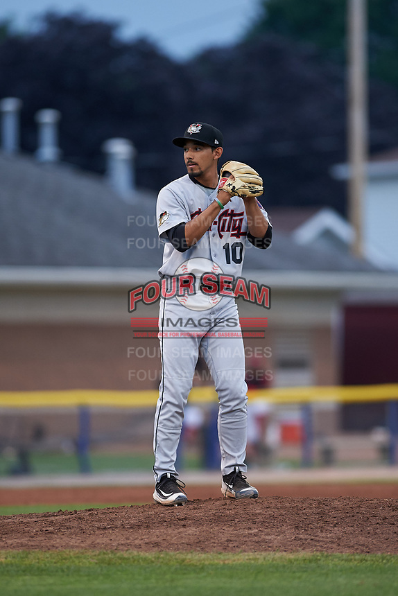Tri-City ValleyCats relief pitcher Luis Ramirez (10) gets ready to deliver a pitch during a game against the Batavia Muckdogs on July 14, 2017 at Dwyer Stadium in Batavia, New York.  Batavia defeated Tri-City 8-4.  (Mike Janes/Four Seam Images)