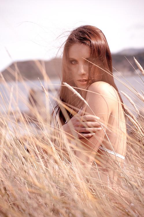 Lexxie Robinson sitting in the reed
