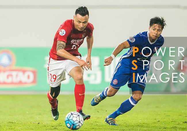 Gao Lin (l) of Guangzhou Evergrande FC runs past Wong Chi Chung of Eastern SC during their AFC Champions League 2017 Match Day 1 Group G match between Guangzhou Evergrande FC (CHN) and Eastern SC (HKG) at the Tianhe Stadium on 22 February 2017 in Guangzhou, China. Photo by Victor Fraile / Power Sport Images