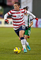 Abby Wambach brings the ball forward in the first half. USWNT played played a friendly against Ireland at JELD-WEN Field in Portland, Oregon on November 28, 2012.